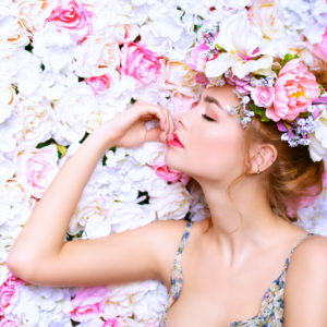 Beautiful Romantic Young Woman In A Wreath Of Flowers Posing On